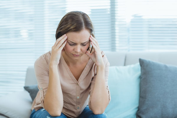 Woman with chronic headache for botox therapy